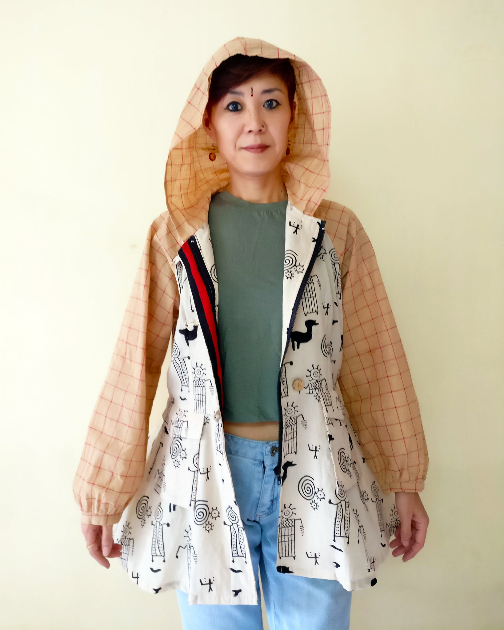 Front, Open, With Hood. MIRCHI KOMACHI Hooded Parka Jacket for ladies is a light casual outer to throw on when it's slightly chilly in winter in tropical regions, hill stations, beach, or for travel. Its cute silhouette allows you various stylings. It's made with thin cotton with folk art print (black). Shop online!