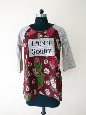 "MIRCHI KOMACHI ""I ain't sorry"" Message Kurti is an experimental item for women who love message T-shirts but are not really happy with ""T-shirts"". This cute brown Hands Kalamkari A-line kurti was upcycled from our left-over cotton fabrics. Only one item in the whole world. Hurry, shop online!"