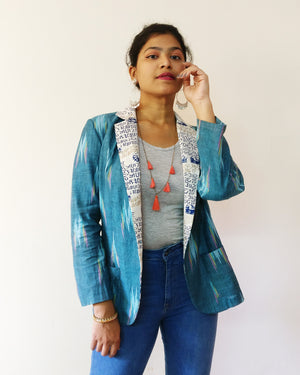 Front : Add this soft cotton blazer jacket with nuanced turquoise Ikat to your wardrobe. This one has a cool twist with calligraphy print. Shop online!