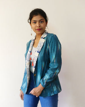 Profile: Add this soft cotton blazer jacket with nuanced turquoise Ikat to your wardrobe. This one has a cool twist with calligraphy print. Shop online!
