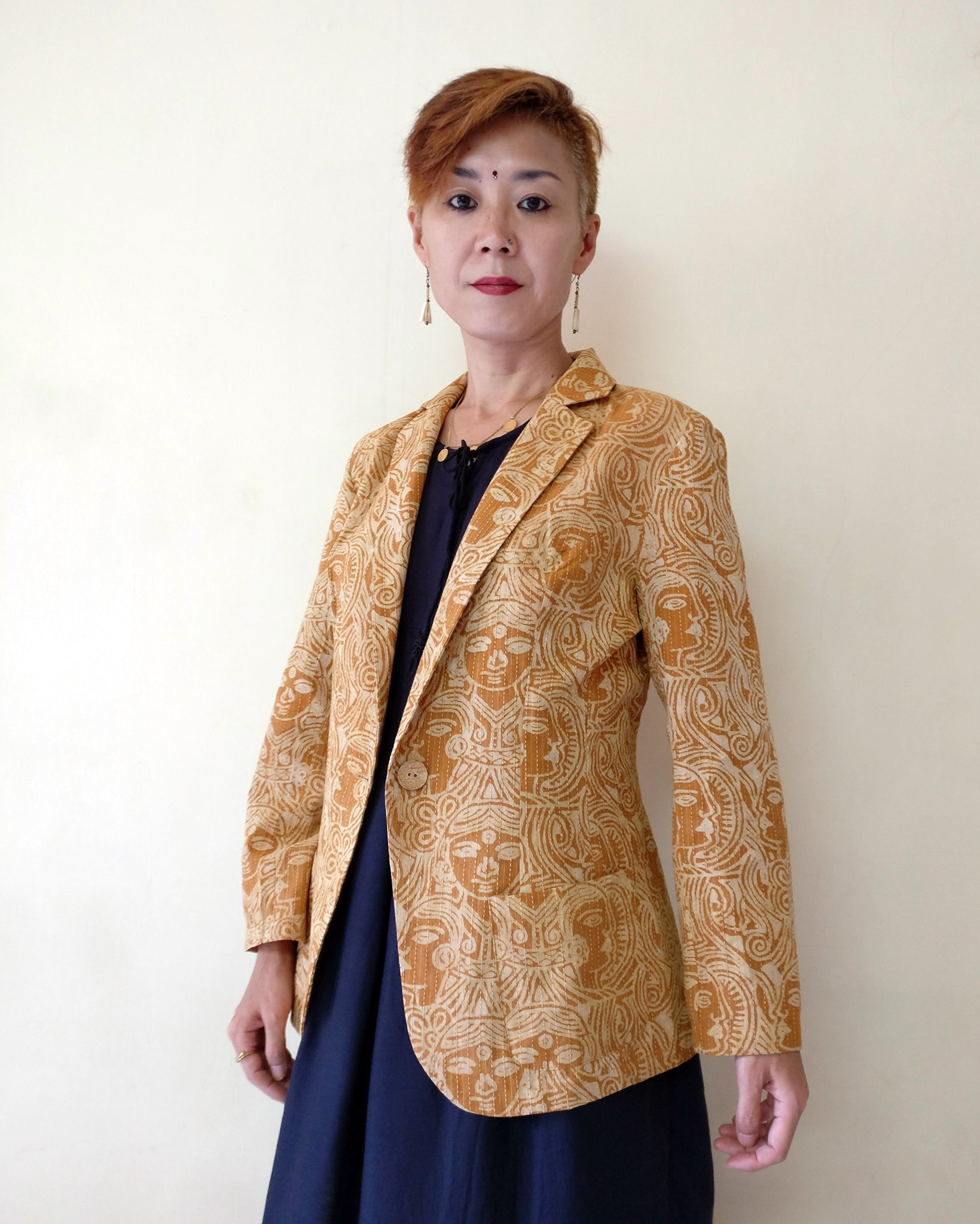 This casual beige blazer for women has running stitch (Kantha) over a block-printed thin cotton fabric. The fabric hasn't become thick but gained the warmth of embroidered fabrics. Working ladies, how about adding this chic jacket to your wardrobe? Shop online!