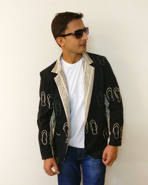 Cool black blazer jacket for men with quirky chappal print. The pinch of cuteness would give a chilled relaxed impression. Shop online!