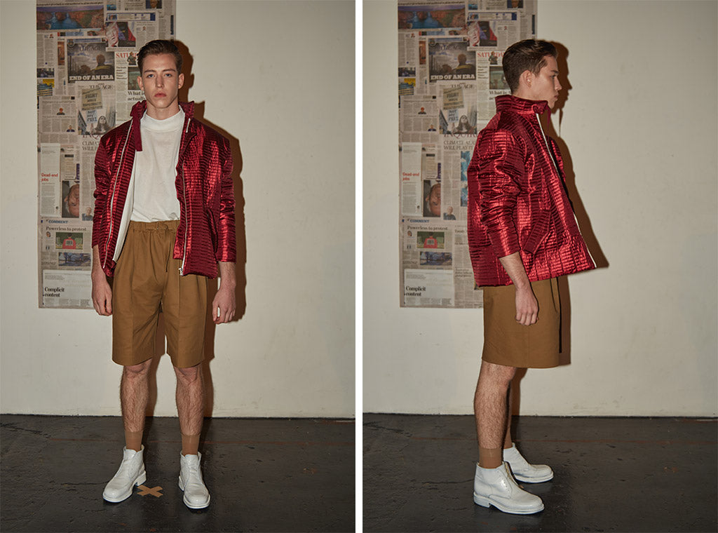 Caramel tailored knee-length shorts paired with white cotton turtle neck top and limited edition red metallic bomber jacket
