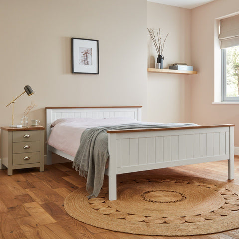 Leah white wooden bed with oak effect trim