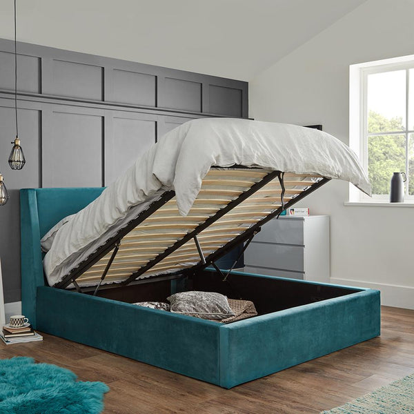 Gas lift pistons holding up an open ottoman bed