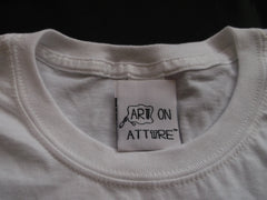Art on Attire™ woven label attached to a neckline of a cotton t-shirt