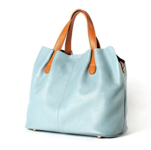 A luxurious soft leather tote to make a girl feel a little bit special. Zipped closure.