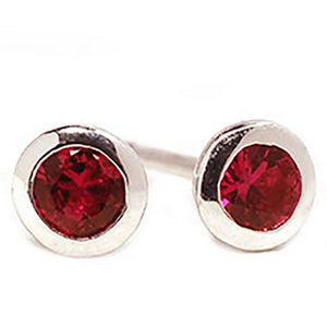 18 Karat White Gold Ruby Bezel Set Stud Earrings - OGI-LTD