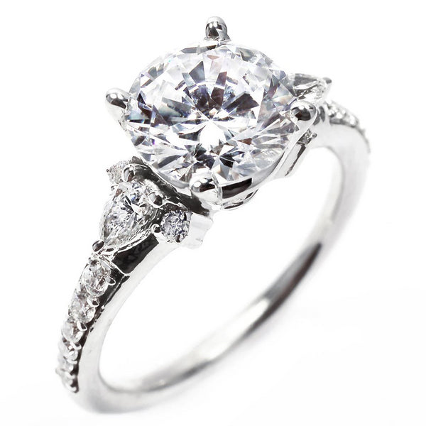 Platinum Round Diamond Engagement Ring with Pear Shape Diamond Sides - OGI-LTD