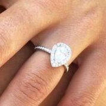 A White Gold Halo Engagement Ring Ready for 1.5 carat Pear Shape Diamond