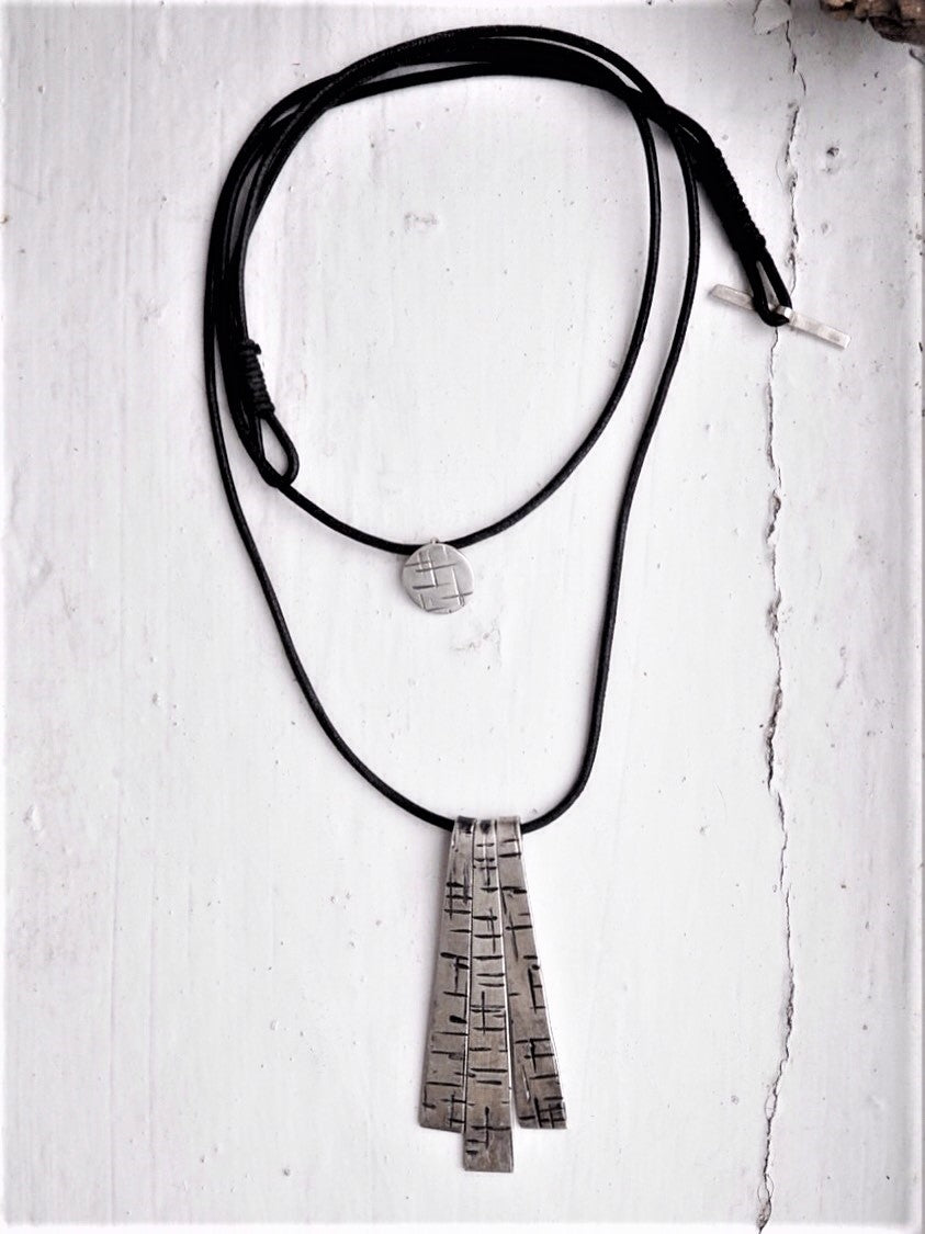 easy ways to layer your necklace, black cord necklace, gothic style necklace