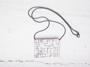 square silver necklace, black chain, hammer marked pendant, handmade