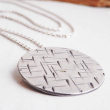 silver round long pendant with hammer marked pattern, contemporary irish jewellery for tomboys