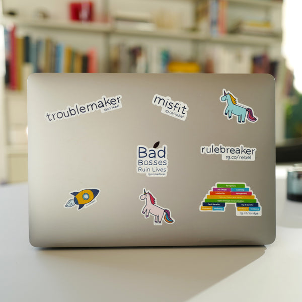 Rebel Playbook for Employee Engagement stickers on MacBook