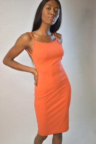 Model wearing orange Saint Tropez Dress