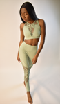 Model standing wearing Glitteractive Evora Set in Pistachio