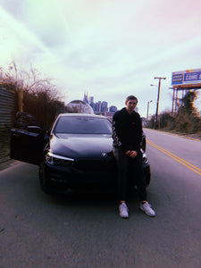 StrictlyBangerzz in front of a car also known as mike ares
