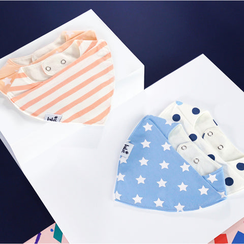 Red, peach and cream and blue and white baby bibs by Bubze Australia.
