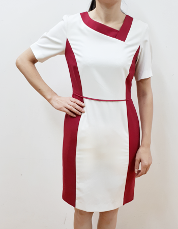 Asymmetric slant collar dress with bold color blocking