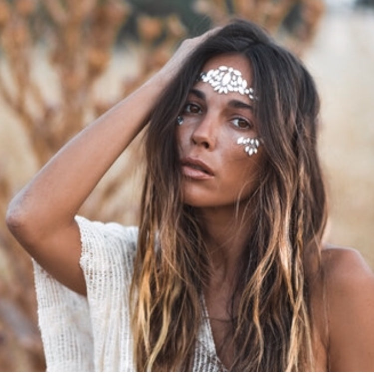 BOHO BEAUTY, bohemian fashion gypsy style makeup. Peel and stick self adhesive face jewels and body gems. Add them to create the perfect festival face. THE GLITTER TRIBE has a wide range of face and body jewels and biodegradable glitter to choose from.