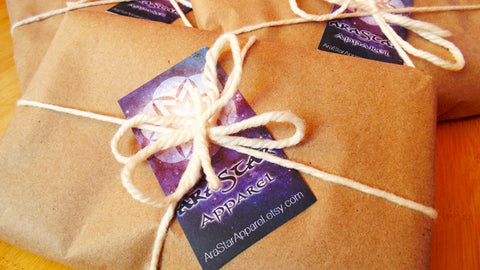gift wrapped package in brown kraft paper with AraStar card and tie