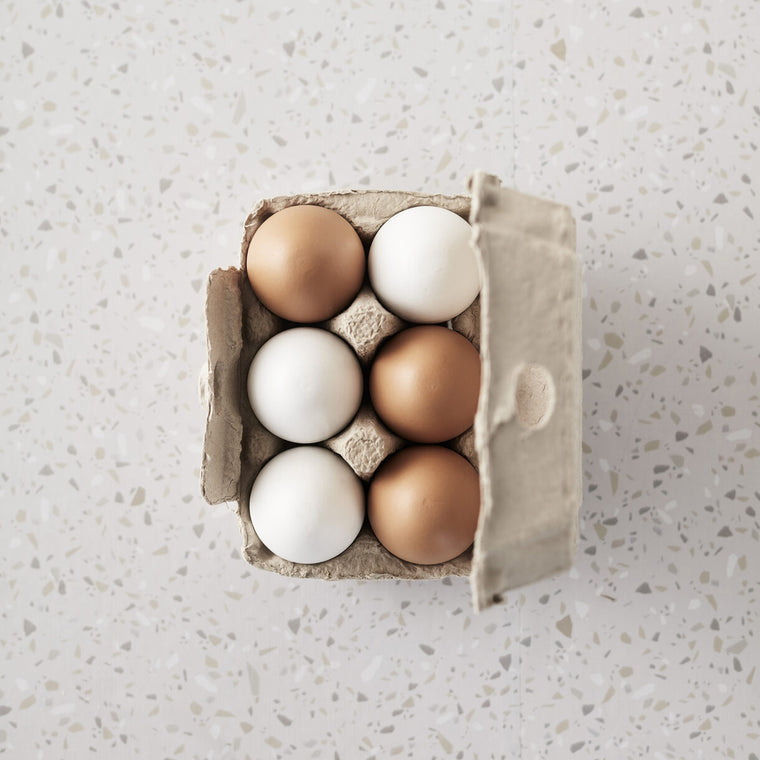 6 wooden eggs in a paper carton from Kids concept