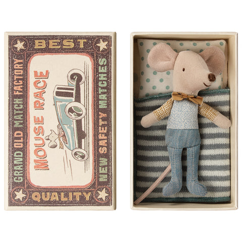 Little brother mouse in box with bow tie. blue and white spotty pillow and striped bedding in a matchbox