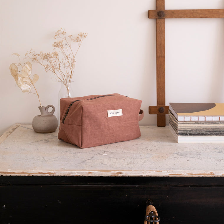natural linen toiletry wash bag in a muted red brown by Monk and Anna
