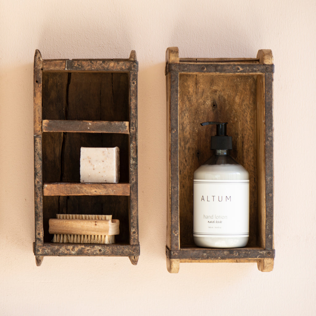 wooden brick moulds from india used as shelving in the bathroom