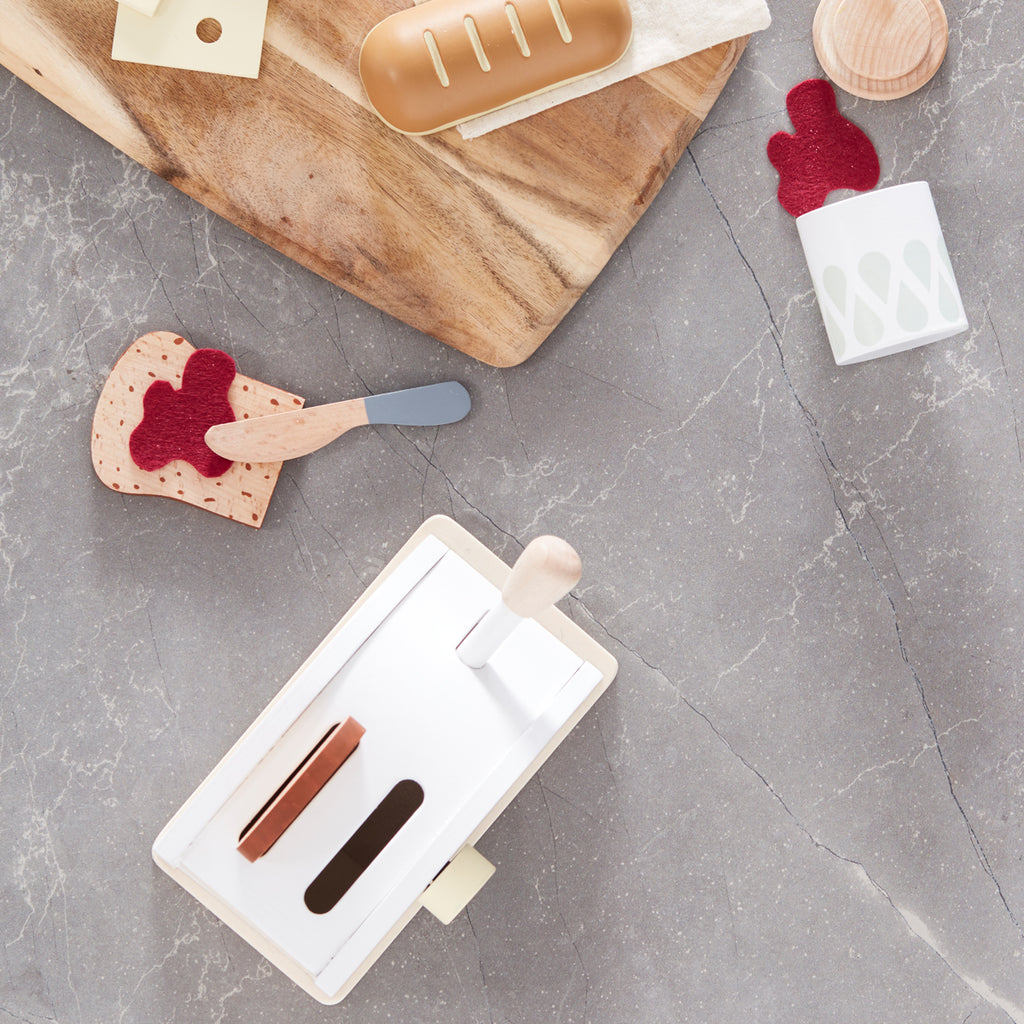 Kids concept Wooden toaster set with jam and a wooden knife