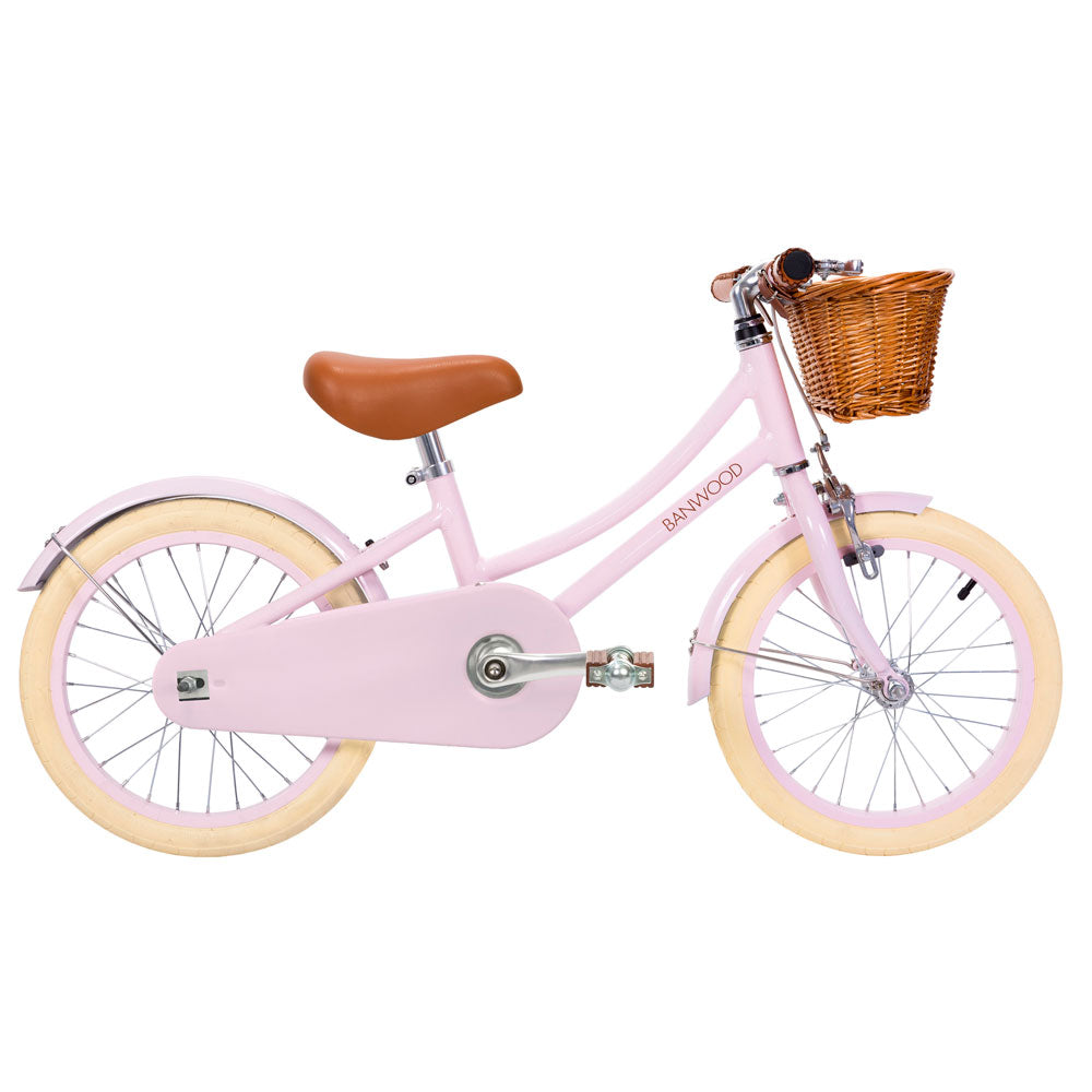 Classic Pink pedal bike from banwood bikes with basket
