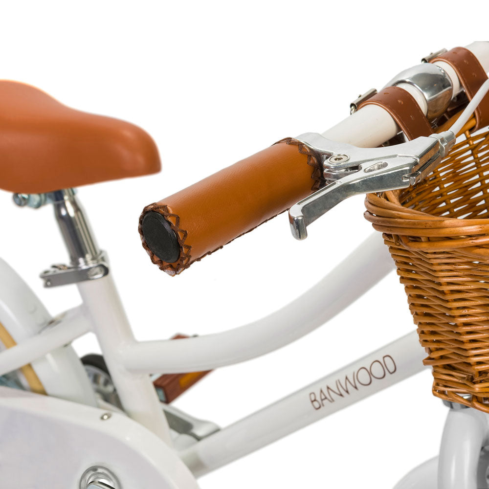 Classic White pedal bike from banwood bikes with basket