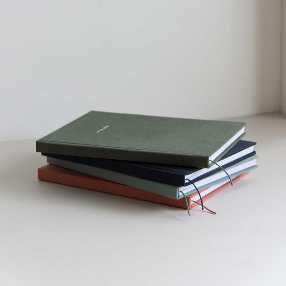 Notebook by Monk and Anna in Washed Linen Dusty Green, brick red, midnight blue and pine green.