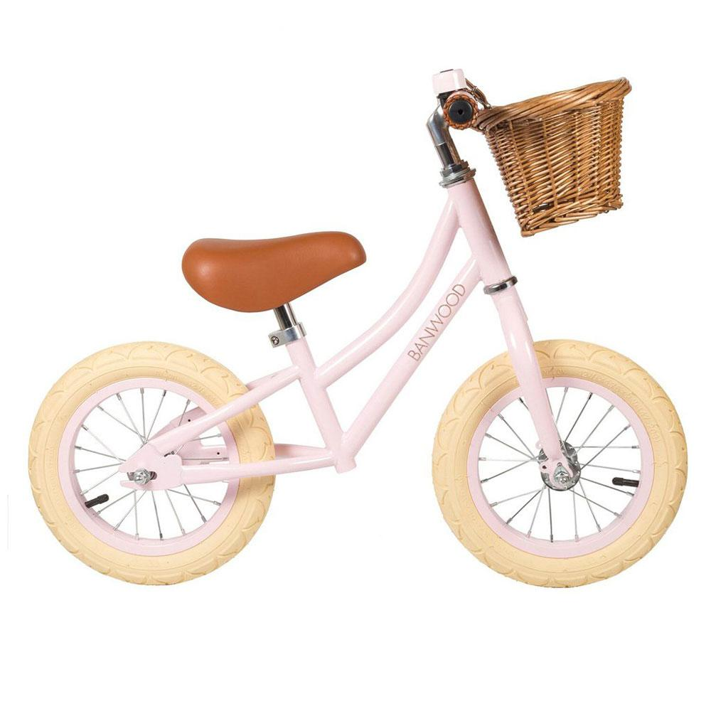 Pink Banwood first go balance bike with basket