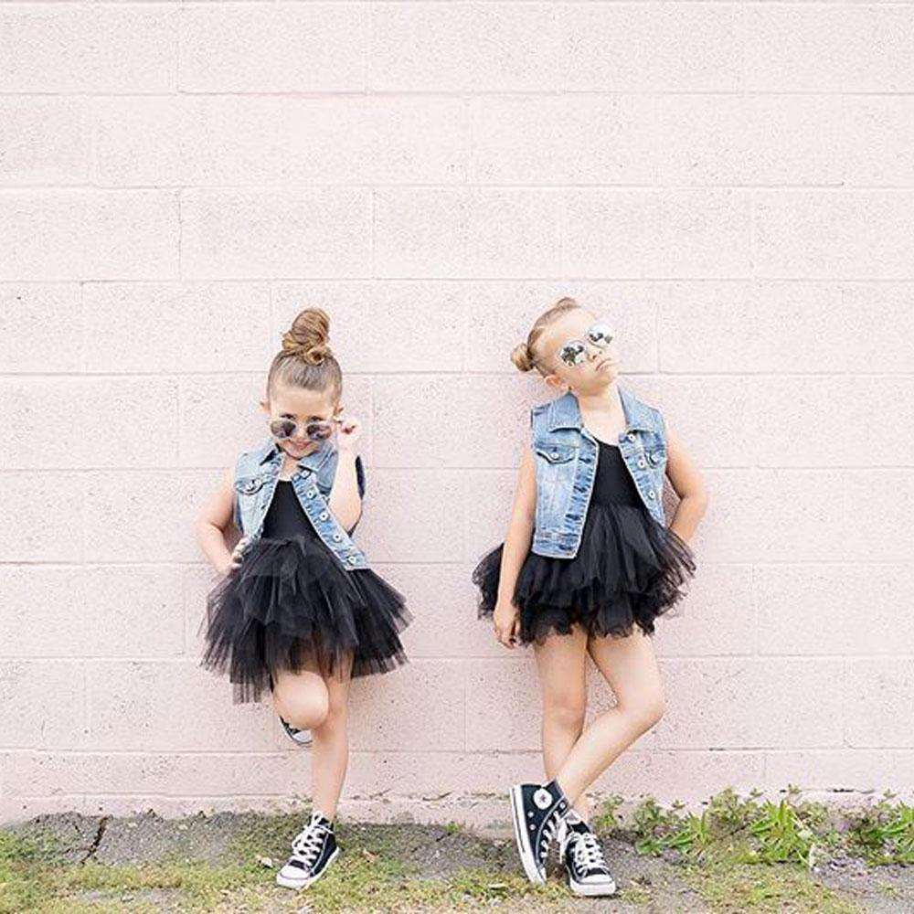 two girls in denim jackets and black i love plum tutus