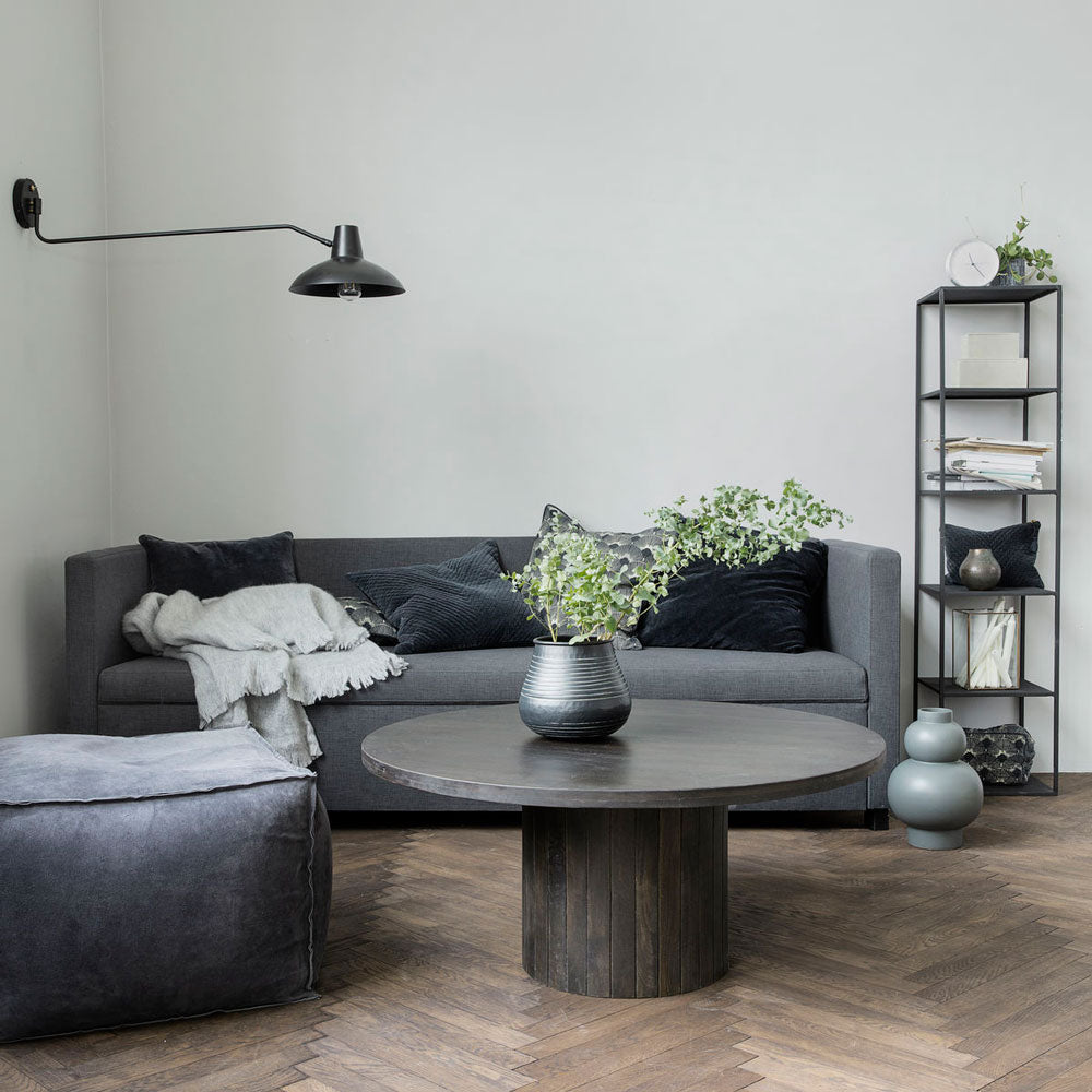 house doctor lounge with grey sofa, black round coffee table and lamps