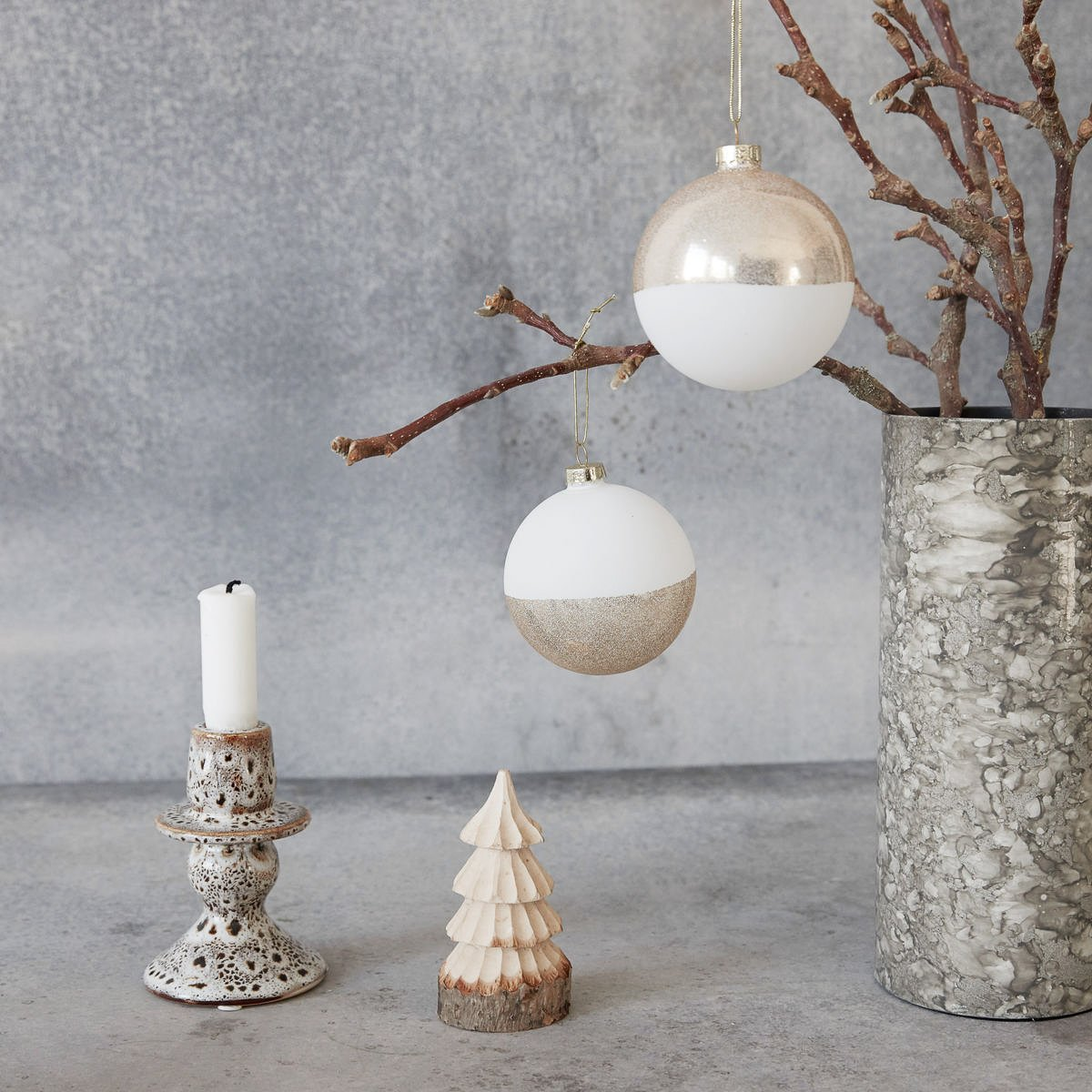 Two gold and white baubles