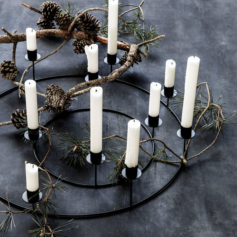metal candle stand in a metal ring with candles from house doctor