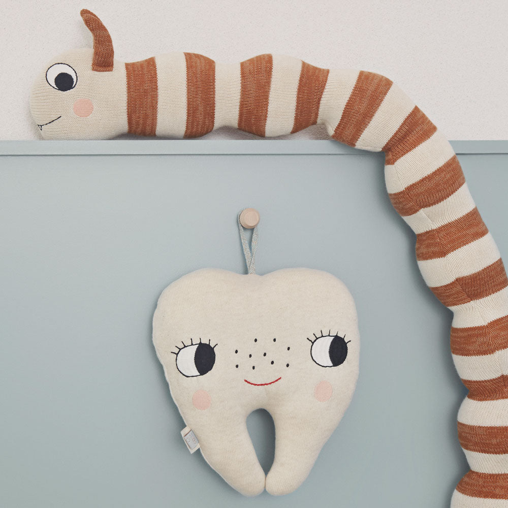 tooth fairy cushion OYOY living design with stripy knitted snake