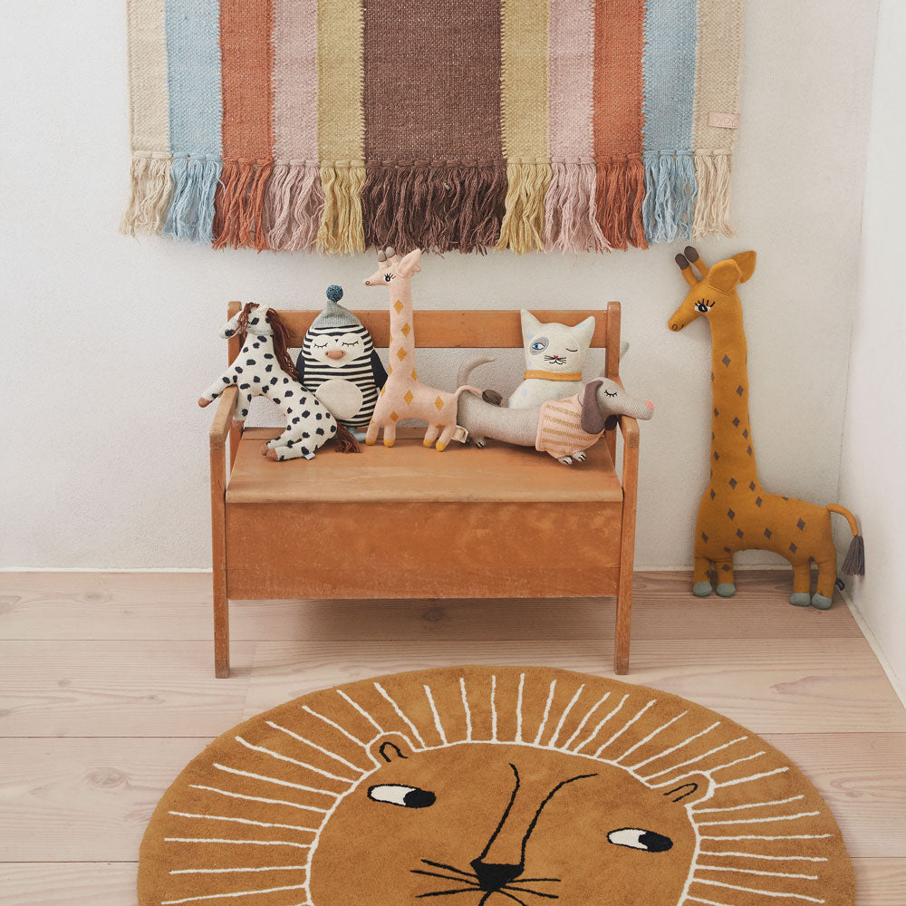 rainbow wall hanging, lion rug and knitted animal cushions by oyoy living design