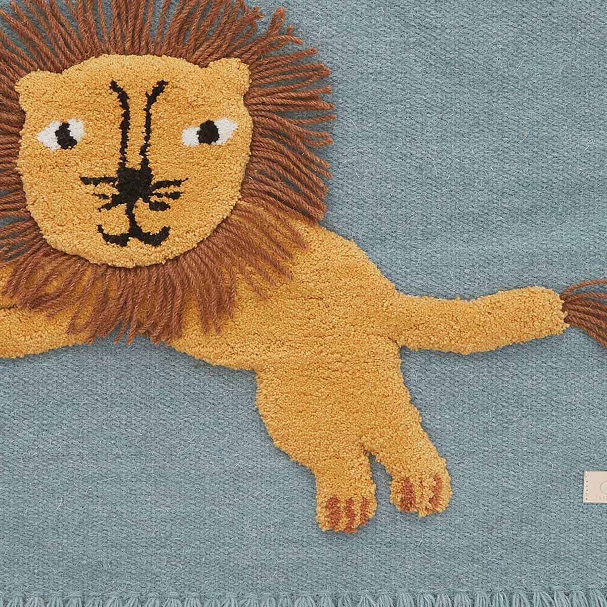 close up of jumping lion wall hanging oyoy living design