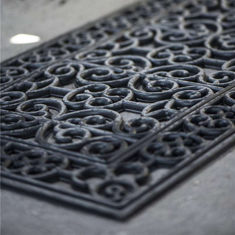 decorative gardening area with rubber doormat