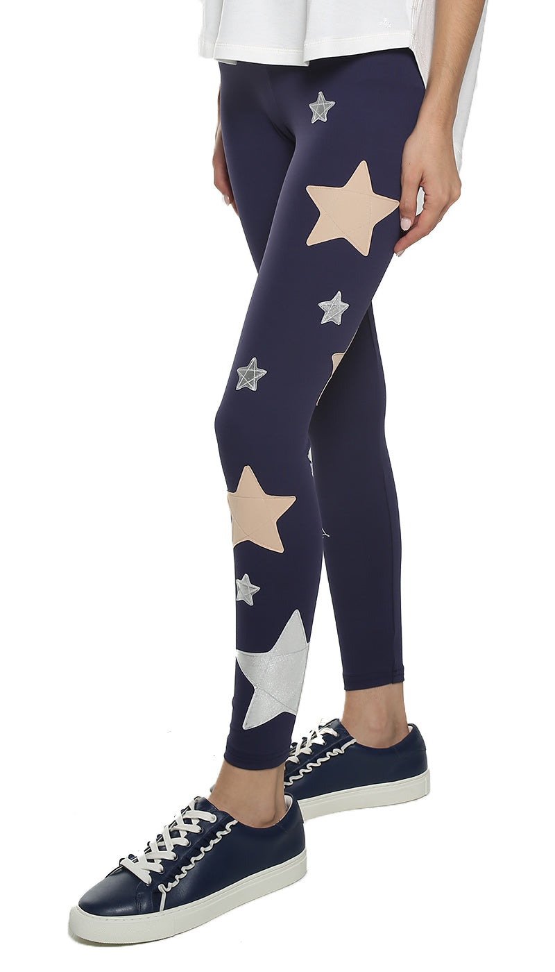 Leggings in lycra blu con stelle applicate rosa cipria e argento