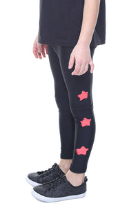 Leggings Bambina in lycra neri con stelle intagliate in lycra corallo
