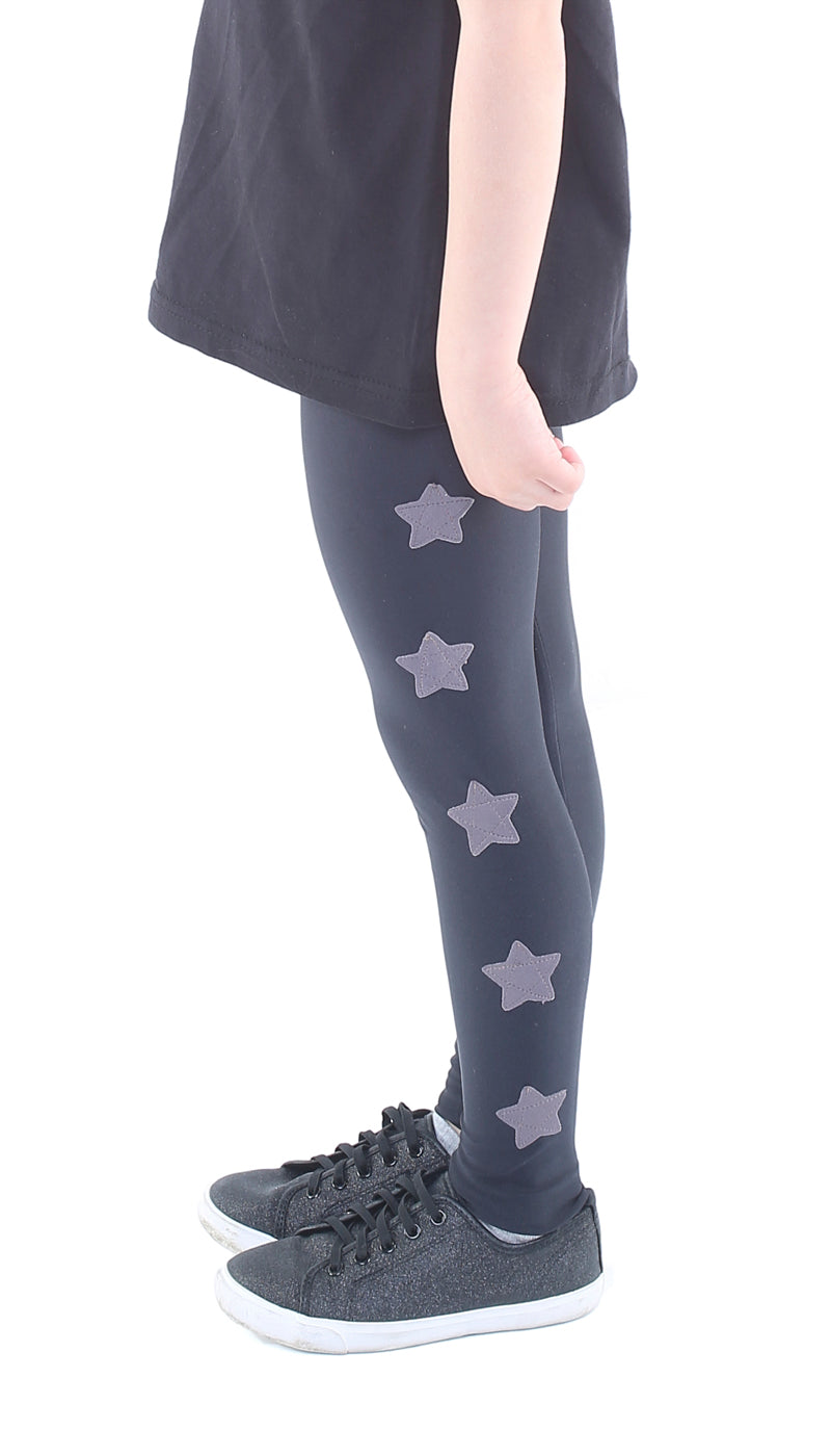 Leggings bambina in lycra neri con stelle applicate grigio magnete