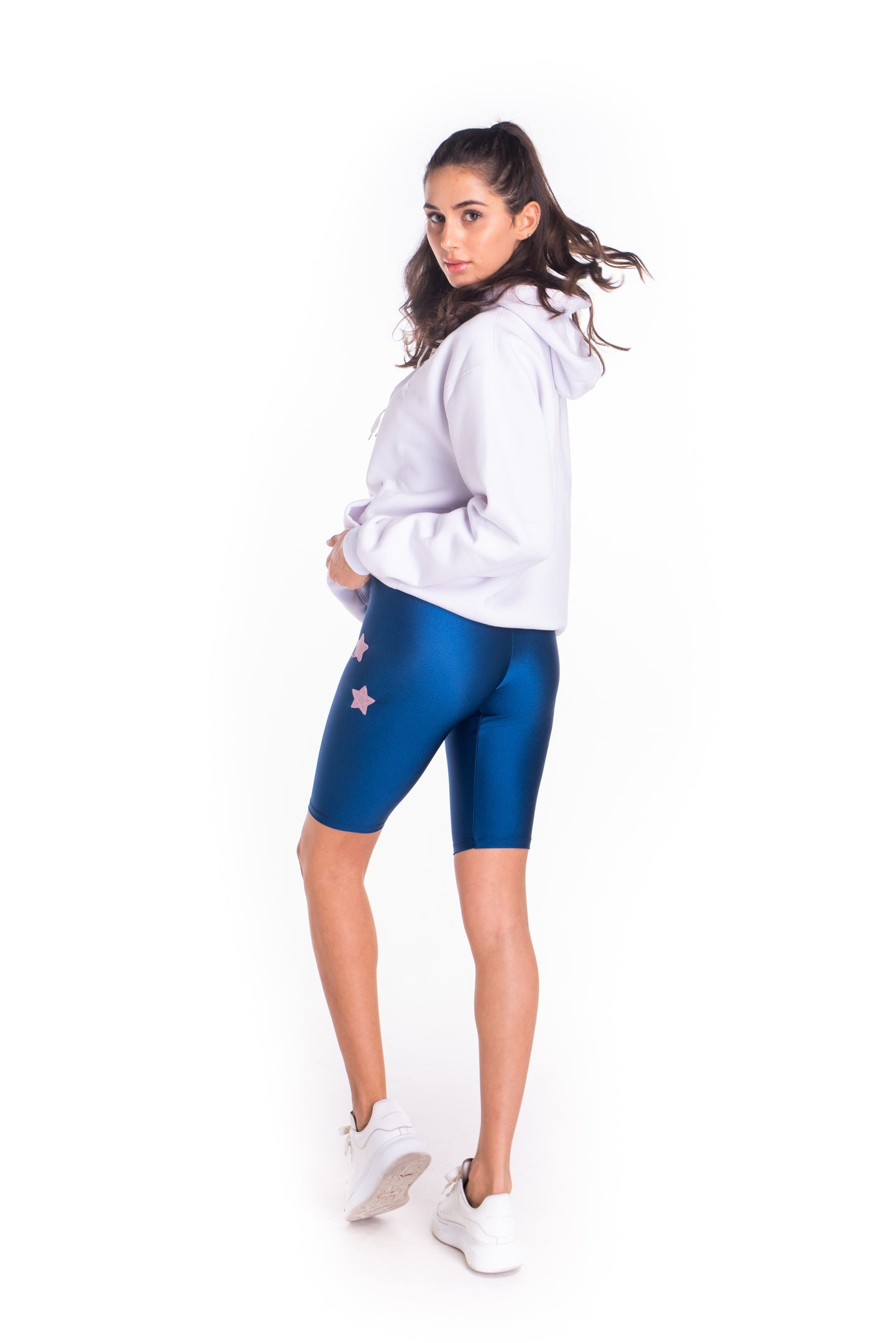 Leggings ciclista in lycra blu laminato con stelle applicate rosa