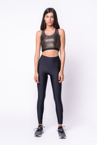 Top in lycra oro ed in lycra nero con stella applicata sul retro oro