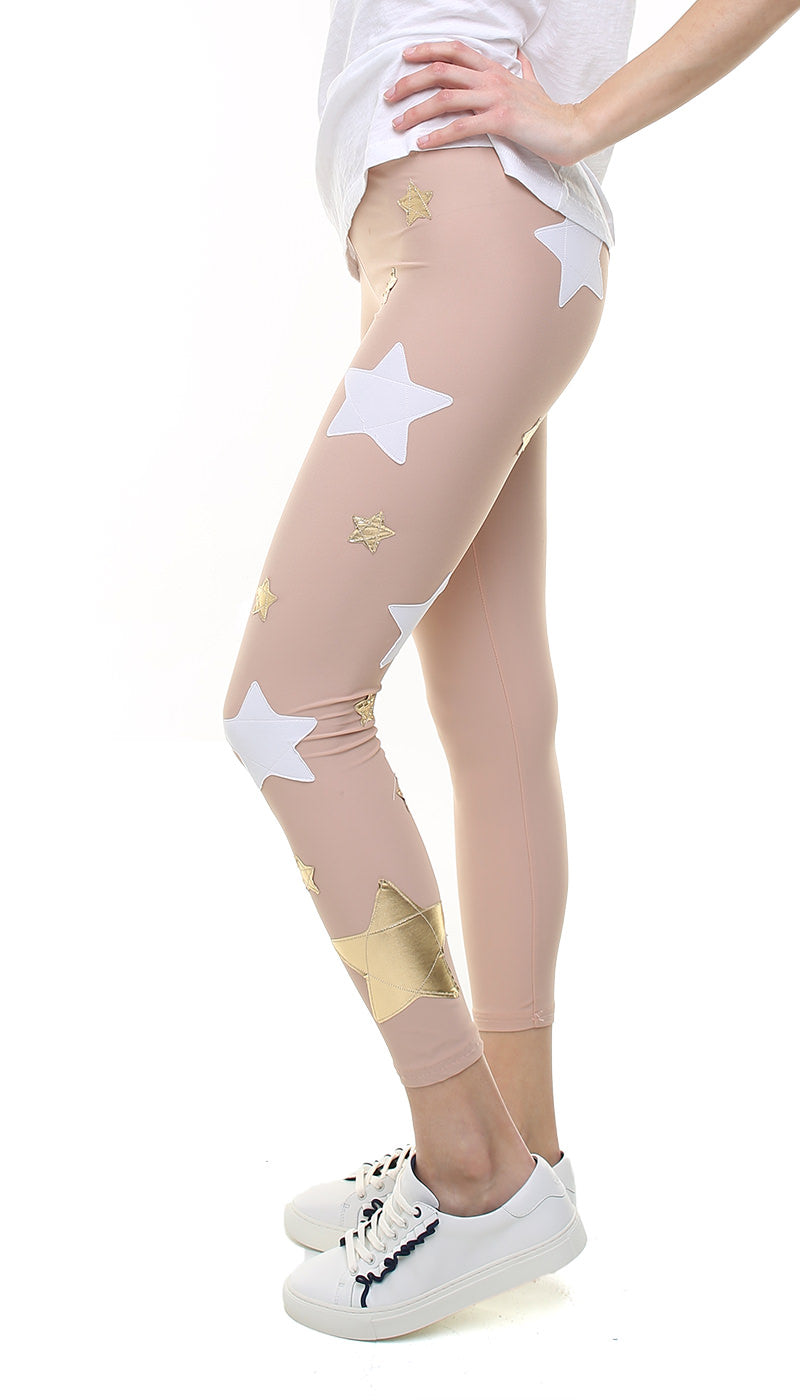 Leggings in lycra rosa cipria con stelle applicate oro e bianche