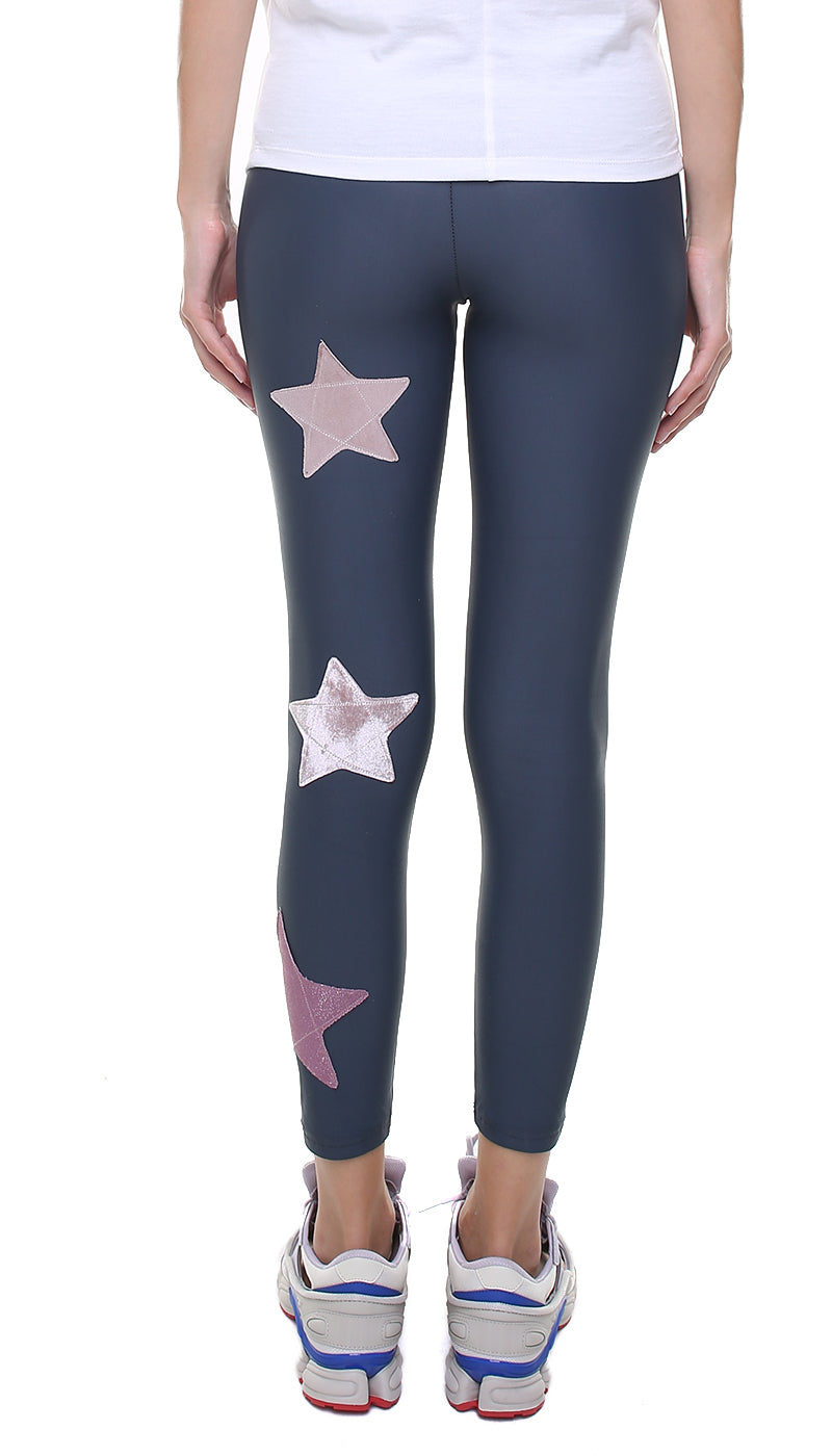 Leggings in lycra grigio piombo con stelle applicate in velluto rosa e in lurex rosa