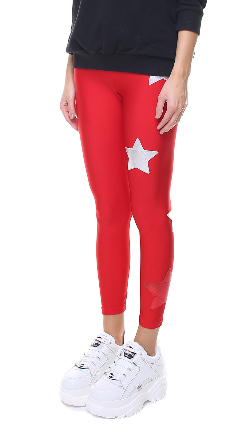 Leggings in lycra rossi con stelle applicate argento e rossa laminata